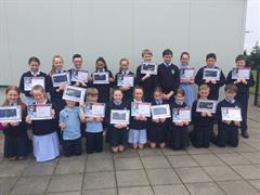 Primary 5  receive ICT certificates.